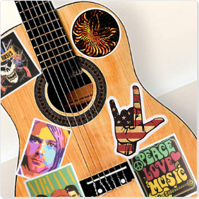 band stickers on the guitar